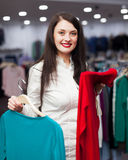 Smiling buyer at fashionable shop Royalty Free Stock Image