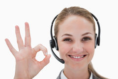 Smiling call center agent approving stock photography