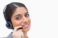 Smiling call center agent with her headset Stock Photography