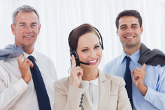 Smiling call center agent posing with her work team Royalty Free Stock Photos