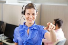 Smiling Call Center Employee Pointing In Office Royalty Free Stock Photos