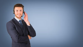 Smiling call center employee during a telephone conversation Royalty Free Stock Photos