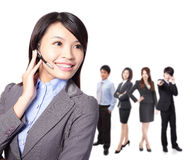 Smiling call center executive with colleagues Royalty Free Stock Photo
