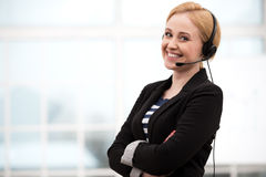 Smiling call center female operator with Royalty Free Stock Image