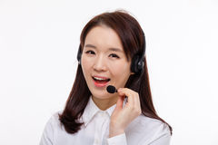 Smiling call center operator business woman Royalty Free Stock Image