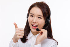 Smiling call center operator business woman show thumbs Stock Photography