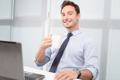 Smiling call center operator drinking tea Stock Image
