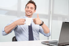 Smiling call center operator drinking tea Royalty Free Stock Photo