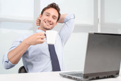 Smiling call center operator drinking tea Royalty Free Stock Photography