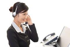 Smiling call center operator Stock Photos