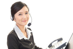 Smiling call center operator Stock Photography