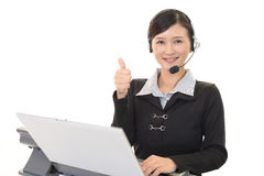 Smiling call center operator Royalty Free Stock Photo