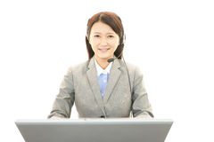 Smiling call center operator Royalty Free Stock Photos