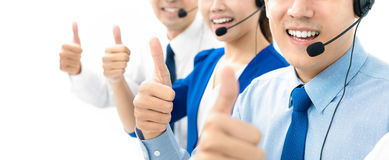 Smiling call center staff giving thumbs up Royalty Free Stock Photo