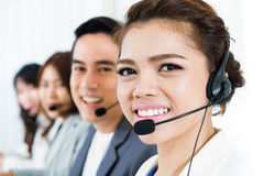 Smiling call center team. Customer service, telemarketer and operator concepts stock image