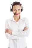Smiling call center woman with folded arms Royalty Free Stock Photography