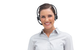 Smiling call centre agent with headset Royalty Free Stock Photo