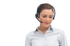 Smiling call centre agent wearing headset Royalty Free Stock Photography