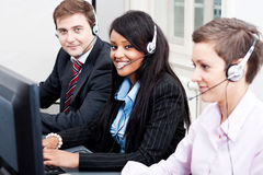 Smiling callcenter agent with headset support Stock Photography