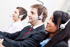 Smiling callcenter agent with headset support Stock Photo