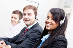 Smiling callcenter agent with headset support Stock Image