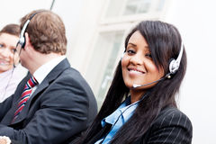 Smiling callcenter agent with headset support Royalty Free Stock Photography