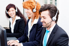 Smiling callcenter agent with headset support Royalty Free Stock Image