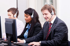 Smiling callcenter agent with headset support Stock Images
