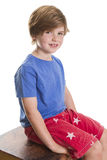 Smiling at the camera. Young boy sitting and smiling at the camera Stock Images