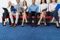 Smiling Candidates Wait For Job Interview, Mix Race Business People Sitting In Line Human Resources Stock Images