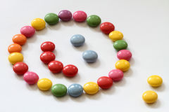 Smiling candy. Smiling children's snack with blue eyes Royalty Free Stock Photo