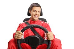 Smiling car racer holding a steering wheel royalty free stock images