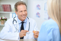 Smiling cardiologist talking to the patient Stock Images
