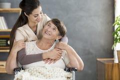 Caregiver hugging patient royalty free stock photos