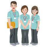 Smiling caregiver staffs. Three smiling professional caregivers standing in full length Stock Photography