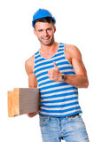 Smiling carpenter gives thumbs up Royalty Free Stock Image