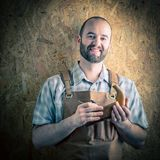 Happy carpenter portrait. Smiling carpenter with hand planer portrait royalty free stock photos