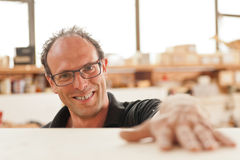 Smiling carpenter in his joiner�s workshop Royalty Free Stock Images