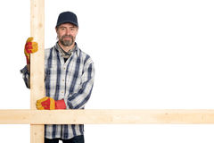 Smiling carpenter holding the planks Stock Photo