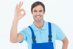Smiling carpenter showing OK sign Stock Photos
