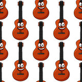 Smiling cartoon acoustic guitar seamless pattern Royalty Free Stock Photography