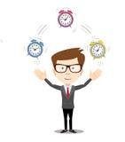 Smiling cartoon businessman juggling with alarm clocks Stock Photo