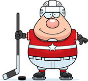 Smiling Cartoon Hockey Player Royalty Free Stock Images