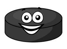 Smiling cartoon hockey puck Royalty Free Stock Photo