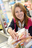 Smiling cashier in grocery store Stock Photography