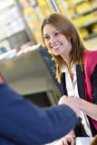 Smiling cashier woman with client Stock Image