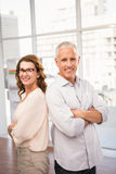 Smiling casual business colleagues with arms crossed. Portrait of smiling casual business colleagues with arms crossed in the office Stock Images