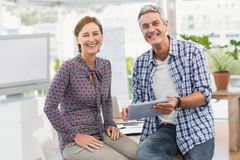 Smiling casual business colleagues with tablet Stock Photos