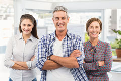 Smiling casual business people with arms crossed. Portrait of smiling casual business people with arms crossed in the office Royalty Free Stock Images