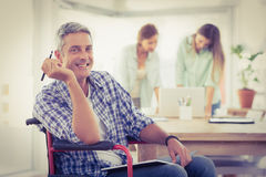 Smiling casual businessman in wheelchair Stock Photo